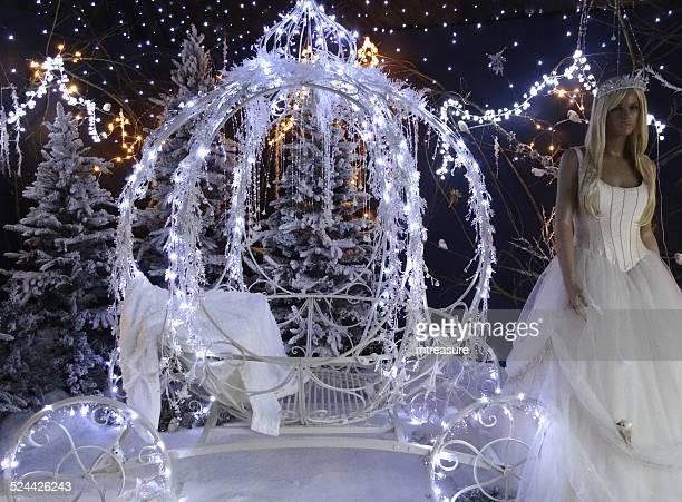 Christmas winter display, Cinderella princess with pumpkin carriage, snow, fairy-lights