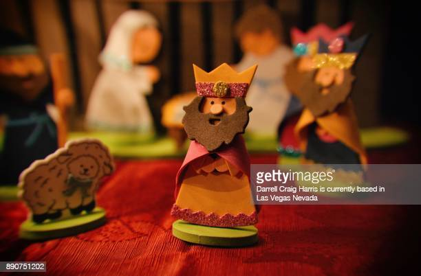 christmas wisemen characters under a christmas tree - three wise men stock photos and pictures