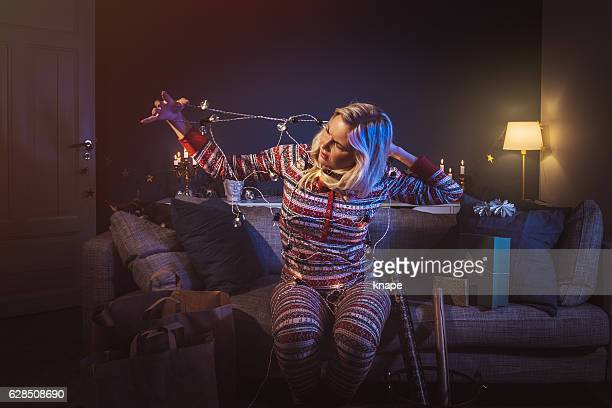 christmas woman at home with christmas lights tangled - dog knotted in woman stock pictures, royalty-free photos & images