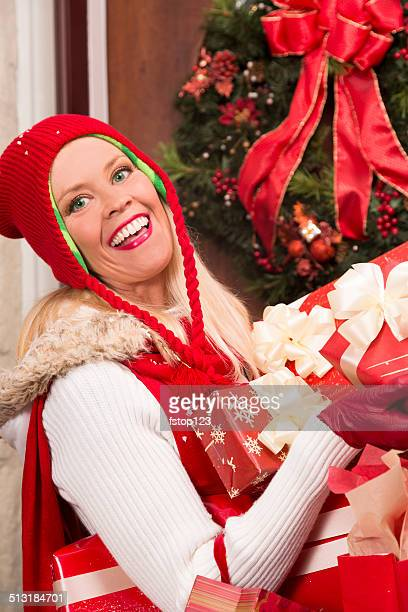 Christmas: Woman delivers holiday gifts or home from shopping day.