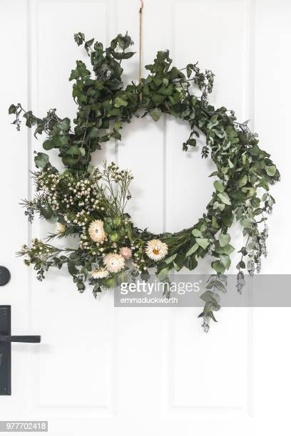 christmas wreath hanging on a door - wreath stock pictures, royalty-free photos & images