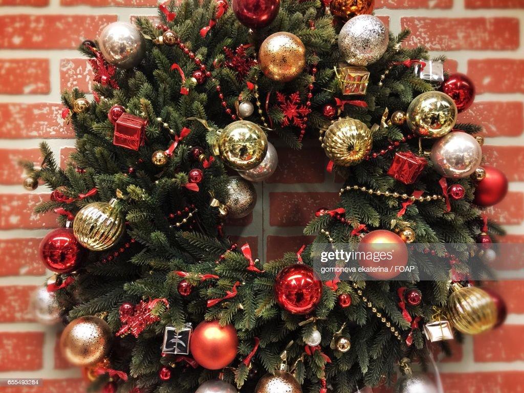christmas wreath hanging on brick wall stock photo