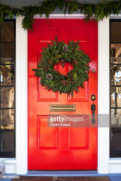 Christmas Wreath Hanging On Red Door Stock Photo Getty Images
