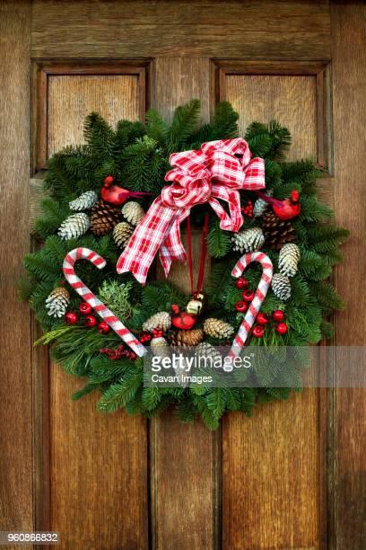Christmas wreath hanging on wooden door