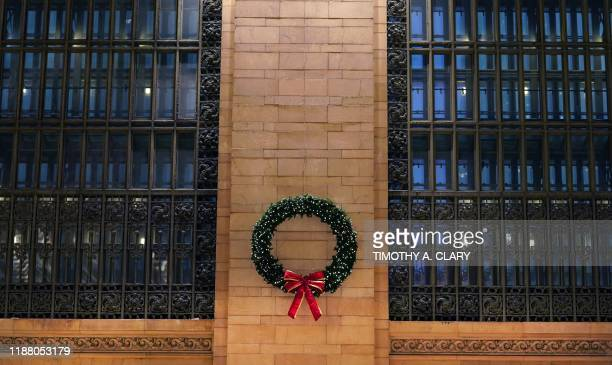 A Christmas Wreath hangs between two of the six 75ft high arched windows at Grand Central Terminal in midtown New York City on December 11 2019