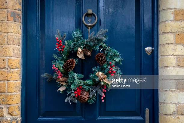 A Christmas wreath hangs on the front door of a residential house in London England on December 20 2018