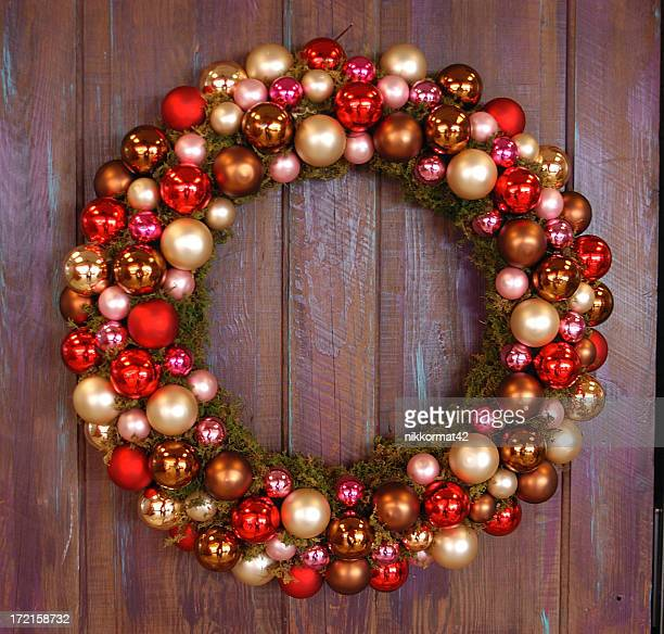 A Christmas wreath of red and gold baubles