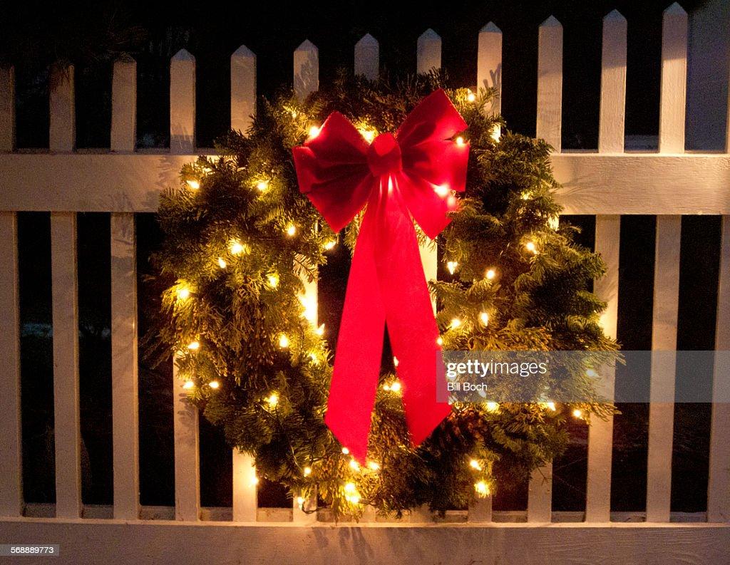 Christmas wreath on a fence : Stock Photo