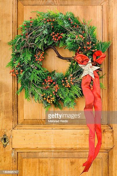Christmas wreath on an old cupboard door
