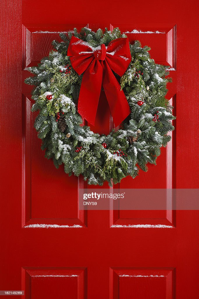 Christmas Wreath On Red Door Stock Photo Getty Images
