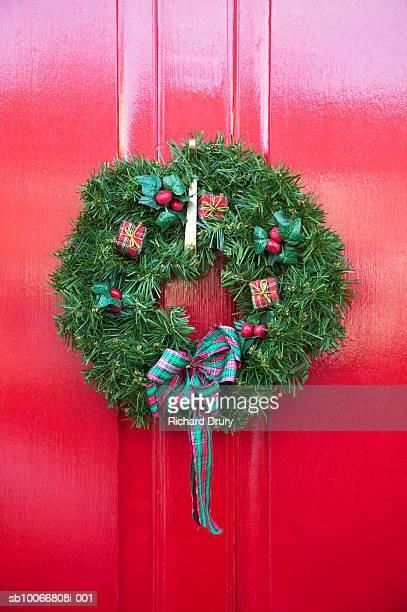 Christmas wreath on red door