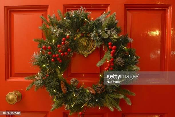 A Christmas wreath seen on a door in Dublin's City Center On Monday December 17 in Dublin Ireland