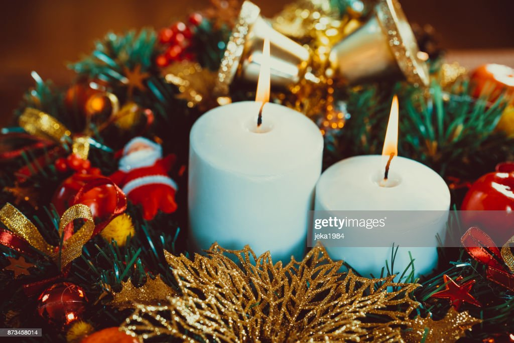 Christmas Wreath With Burning Candles On Wooden Table Beautiful Xmas ...