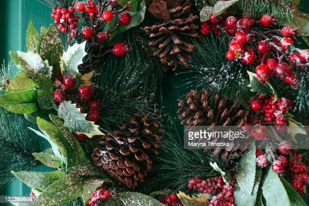 christmas wreath with pine cones on the door. - christmas bauble stock pictures, royalty-free photos & images