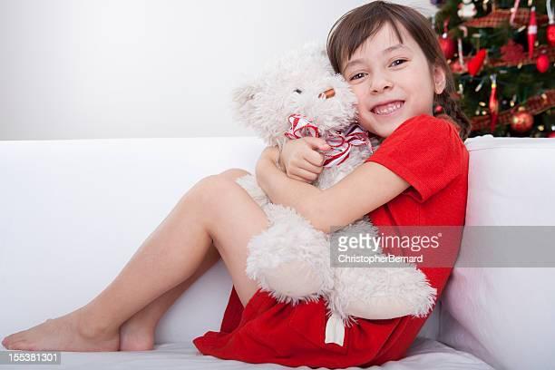 Christmas-Happy Girl hugging teddy bear