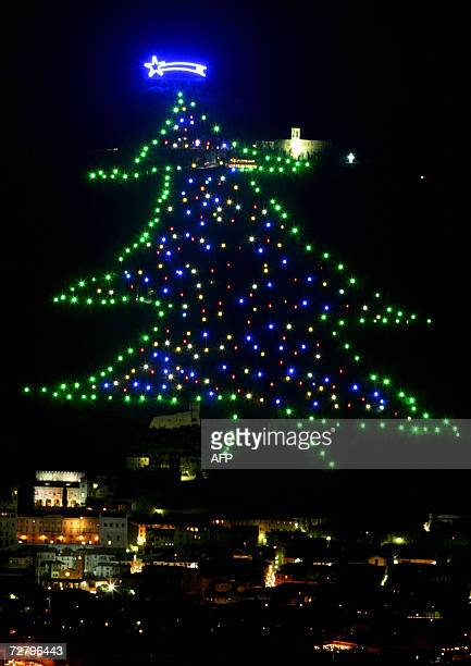 Christmass tree decorates Mount Ingino overlooking the Umbrian city of Gubbio 11 December 2006 The tree is 650 meters long with a surface area around...