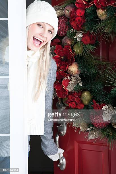 Christmas-Smiling woman at front door