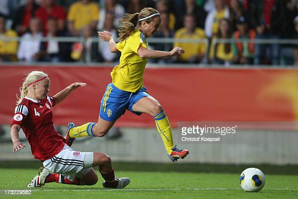 Christna Oerntoft of Denmark fouls Kosovare Asllani of Sweden in the penalty area during the UEFA Women's EURO 2013 Group A match between Sweden and...