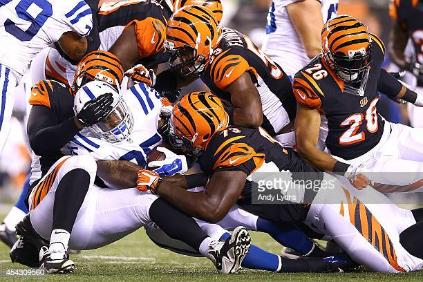 Christo Bilukidi, Trey Hopkins, and Marquis Flowers, all of the Cincinnati Bengals, combine to tackle David Fuellen of the Indianapolis Colts during...
