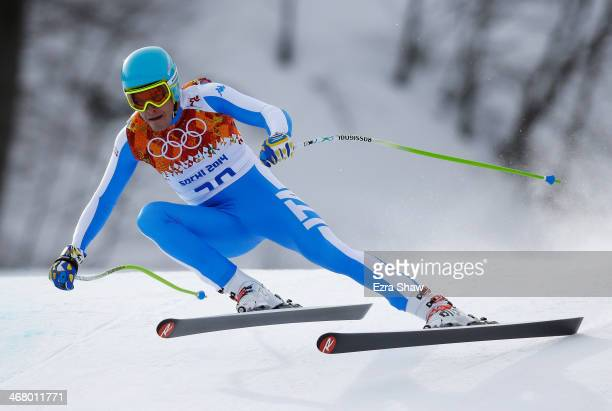 Christof Innerhofer of Italy in action during the Alpine Men's Downhill on day two of the Sochi 2014 Winter Olympics at Rosa Khutor Alpine Center on...