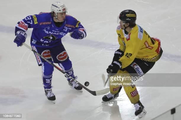 Christof Kromp of Villach and Sondre Olden of Vienna during the Vienna Capitals v EC VSV Erste Bank Eishockey Liga at Erste Bank Arena on January 18...
