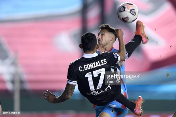 Christofer Gonzales of Sporting Cristal scores the first goal of his team during a round of sixteen second leg match between Arsenal and Sporting...