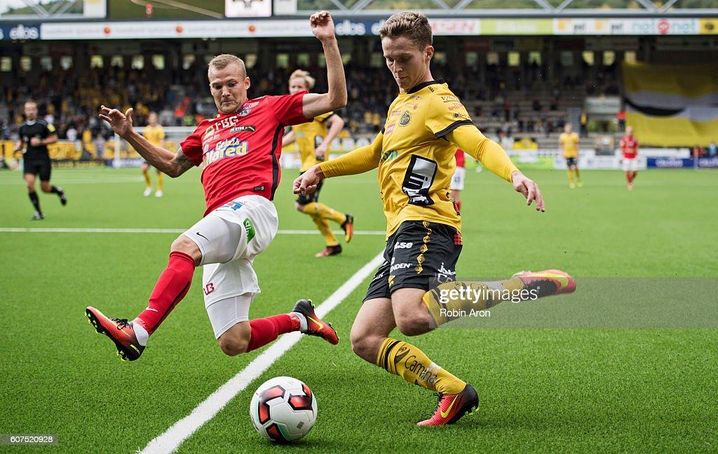 Christoffer Carlsson of Falkenbergs FF tries to stop Adam Lundqvist ... 2e9c3afaf093f