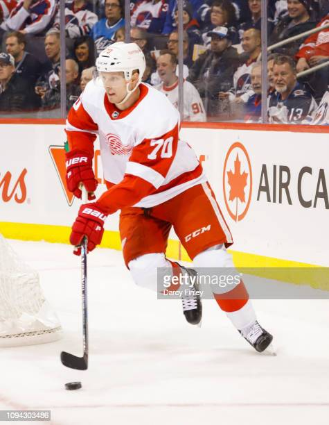 Christoffer Ehn of the Detroit Red Wings plays the puck around the net during first period action against the Winnipeg Jets at the Bell MTS Place on...