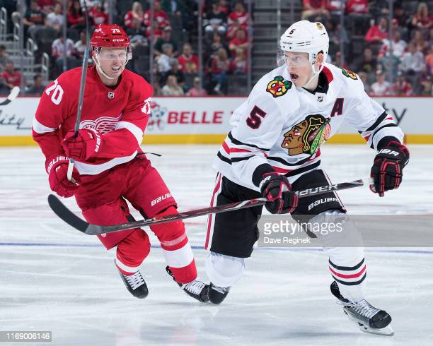 Christoffer Ehn of the Detroit Red Wings skates after Connor Murphy of the Chicago Blackhawks during a pre-season NHL game at Little Caesars Arena on...