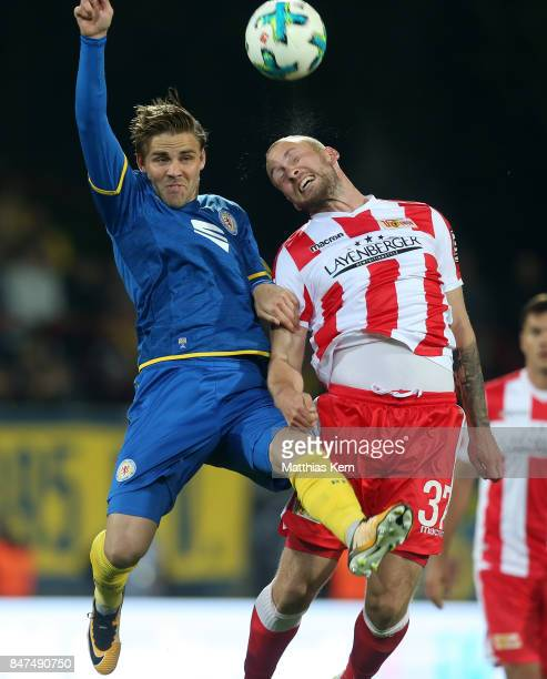 Christoffer Nyman of Braunschweig and Toni Leistner of Berlin jump for a header during the Second Bundesliga match between 1 FC Union Berlin and...