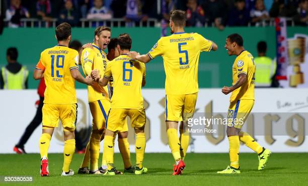 Christoffer Nymann of Braunschweig celebrate with his team mates after he scores the opening goal during the DFB Cup first round match between...