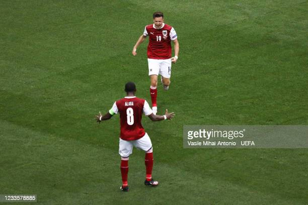 Christoph Baumgartner celebrates the goal with David Alaba during the UEFA Euro 2020 Championship Group C match between Ukraine and Austria at...