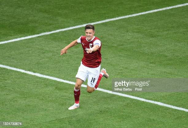 Christoph Baumgartner of Austria celebrates after scoring their side's first goal during the UEFA Euro 2020 Championship Group C match between...