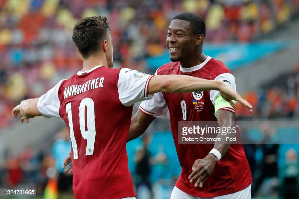 Christoph Baumgartner of Austria celebrates with David Alaba after scoring their side's first goal during the UEFA Euro 2020 Championship Group C...