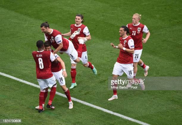 Christoph Baumgartner of Austria celebrates with David Alaba and Aleksandar Dragovic after scoring their side's first goal during the UEFA Euro 2020...