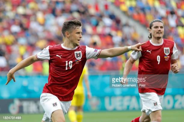 Christoph Baumgartner of Austria celebrates with Marcel Sabitzer after scoring their side's first goal during the UEFA Euro 2020 Championship Group C...