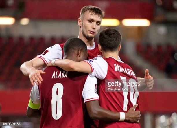 Christoph Baumgartner of Austria celebrates with team mates after scoring their side's second goal during the FIFA World Cup 2022 Qatar qualifying...