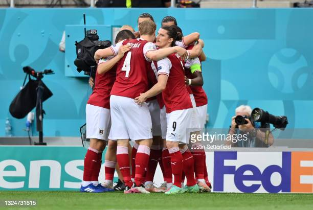 Christoph Baumgartner of Austria celebrates with team mates after scoring their side's first goal during the UEFA Euro 2020 Championship Group C...