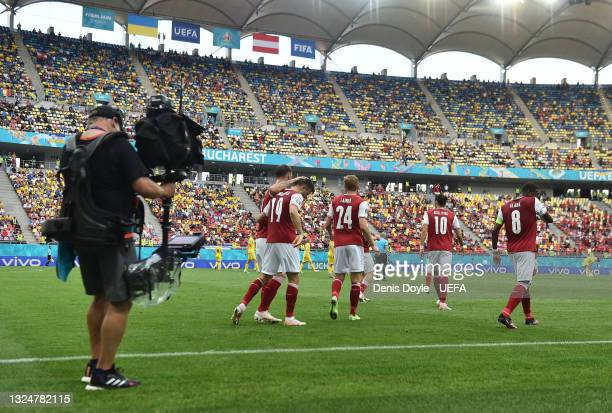 Christoph Baumgartner of Austria celebrates with teammates after scoring their side's first goal during the UEFA Euro 2020 Championship Group C match...