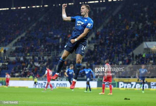 Christoph Baumgartner of Hoffenheim celebgrates scoring their third goal during the Bundesliga match between TSG Hoffenheim and 1. FC Köln at...