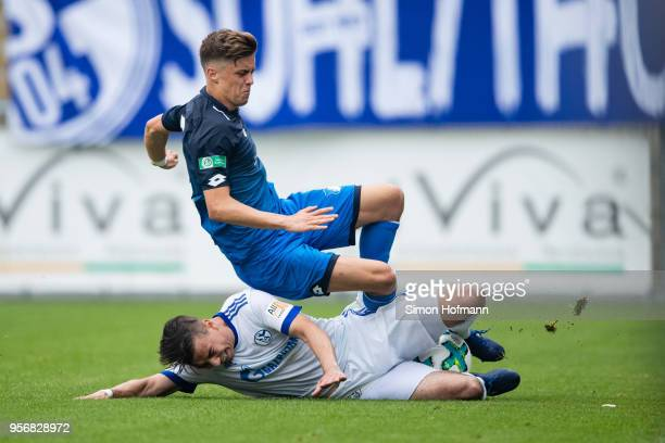Christoph Baumgartner of Hoffenheim is fouled by Andriko Smolinski of Schalke during the German A Juniors Championship Semi Final Leg One match...
