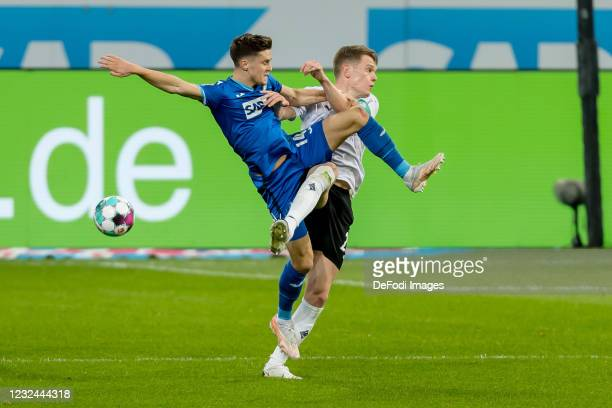 Christoph Baumgartner of TSG 1899 Hoffenheim and Stefan Lainer of Borussia Moenchengladbach battle for the ball during the Bundesliga match between...