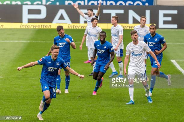 Christoph Baumgartner of TSG 1899 Hoffenheim celebrates after scoring his team's third goal with teammates during the Bundesliga match between TSG...