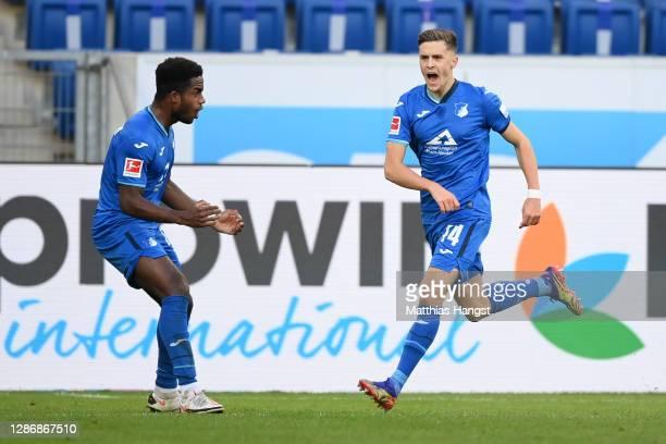 Christoph Baumgartner of TSG 1899 Hoffenheim celebrates with teammate Ryan Sessegnon after scoring his team's first goalduring the Bundesliga match...