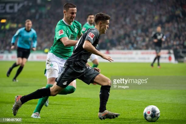 Christoph Baumgartner of TSG Hoffenheim and Marco Friedl of SV Werder Bremen battle for the ball during the Bundesliga match between SV Werder Bremen...