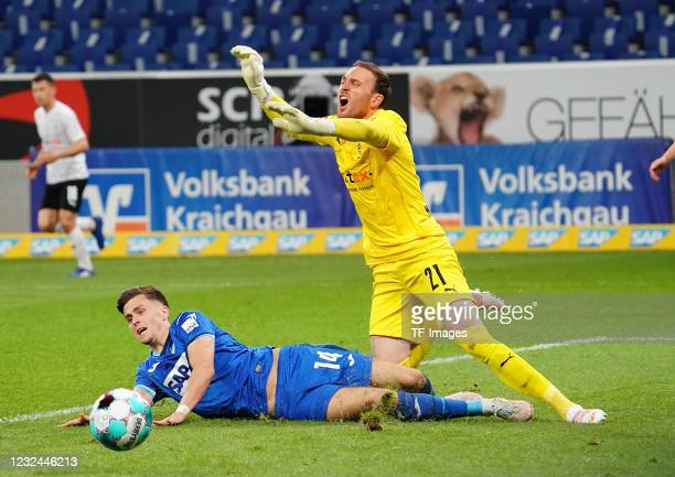 Christoph Baumgartner of TSG Hoffenheim, goalkeeper Tobias Sippel of Borussia Moenchengladbach during the Bundesliga match between TSG Hoffenheim and...