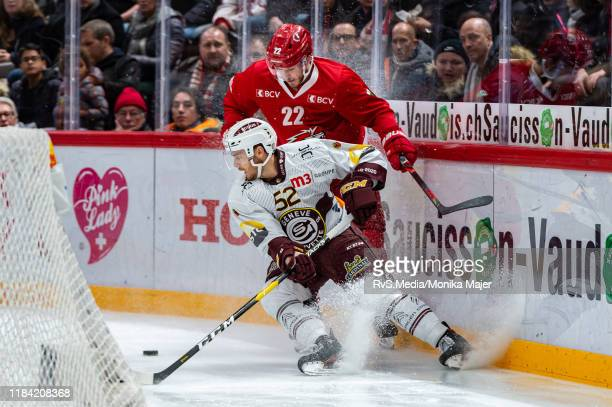 Christoph Bertschy of Lausanne HC battles for the puck with Mike Vollmin of GeneveServette HC during the Swiss National League game between Lausanne...