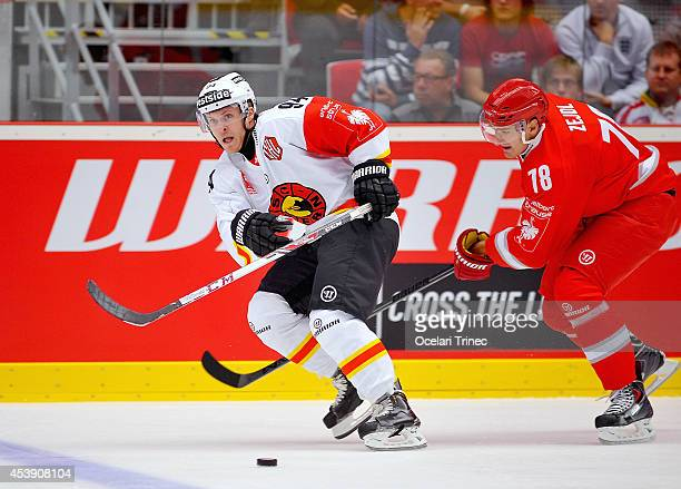 Christoph Bertshy of SC Bern and Lukas Zejdl of HC Ocelari Trinec compete during the Champions Hockey League group stage game between HC Ocelari...