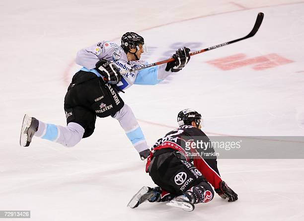 Christoph Brandner of Hamburg shots after a missed challenge by Jason Marshall of Cologne during the DEL Bundesliga match between Hamburg Freezers...