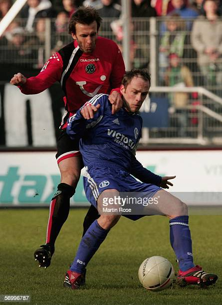 Christoph Dabrowski of Hannover and Fabain Ernst of Schalke fight for the ball during the Bundesliga match between Hanover 96 and FC Schalke 04 at...